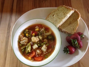 Homemade veggie soup, strawberries, and bread 15 grams of protein